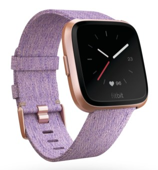 Product render of Fitbit Versa in 3 quarter view with special edition lavender woven band and rose gold aluminum body