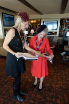 Our betting expert Katie helping place a few key bets at the Longines box seat in the mansion.