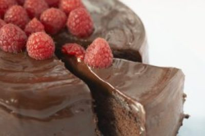 Image, iced chocolate cake with raspberries.