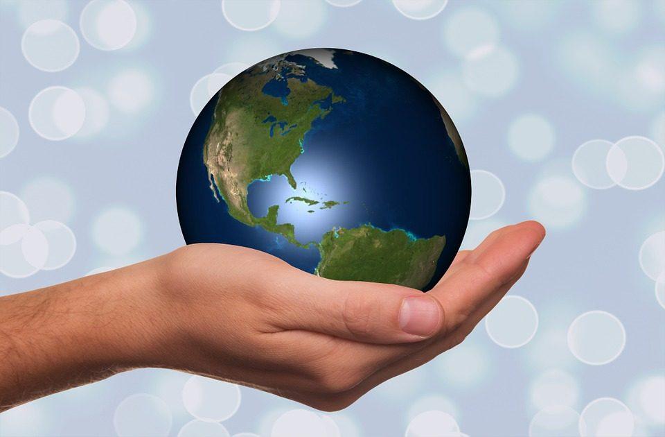 Image, Hand holding a globe.