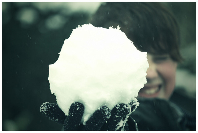 Image, Person squinting at a big snowball.