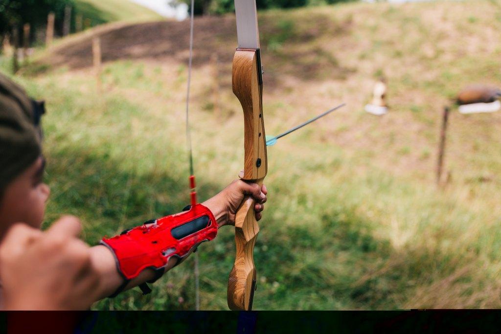 Photo of archer firing an arrow.