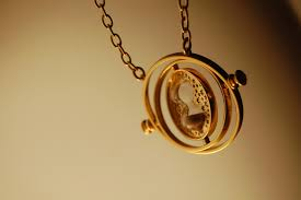 Photo of a Time-Turner - an intricate gold pendant on a chain.