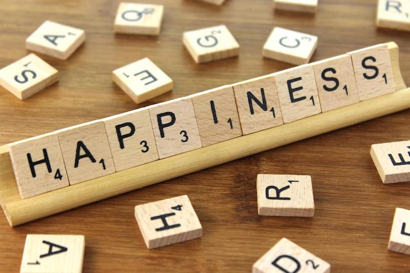 Image, Scrabble tiles spelling out HAPPINESS.