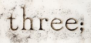 Image of the word 'three', followed by a semicolon.