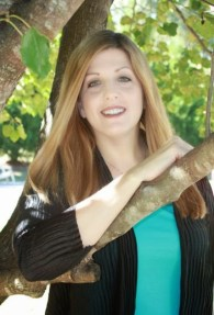 Sally Matheny leaning on a tree
