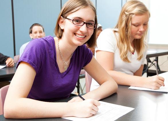 Teen girl writing signature change