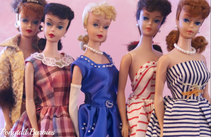 Row of Barbies ready to kill zombies with a sneer