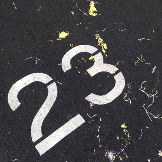 Number 23 on footpath with yellow and white squiggles
