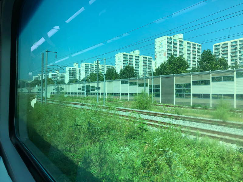 Apartment blocks seen from a train window.