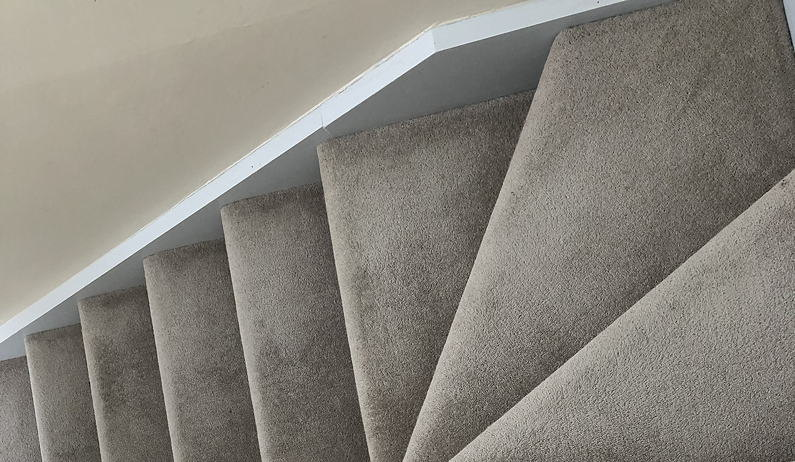 Photo of narrow carpeted stairs