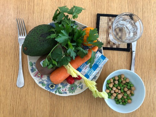 plate of fresh fruit and vegetables with peas, chickpeas, water and aspirin