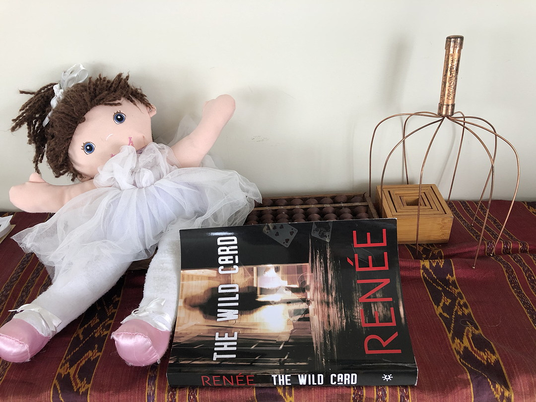 doll, book The Wild Card by Renee, nest of boxes and orgasmatron?