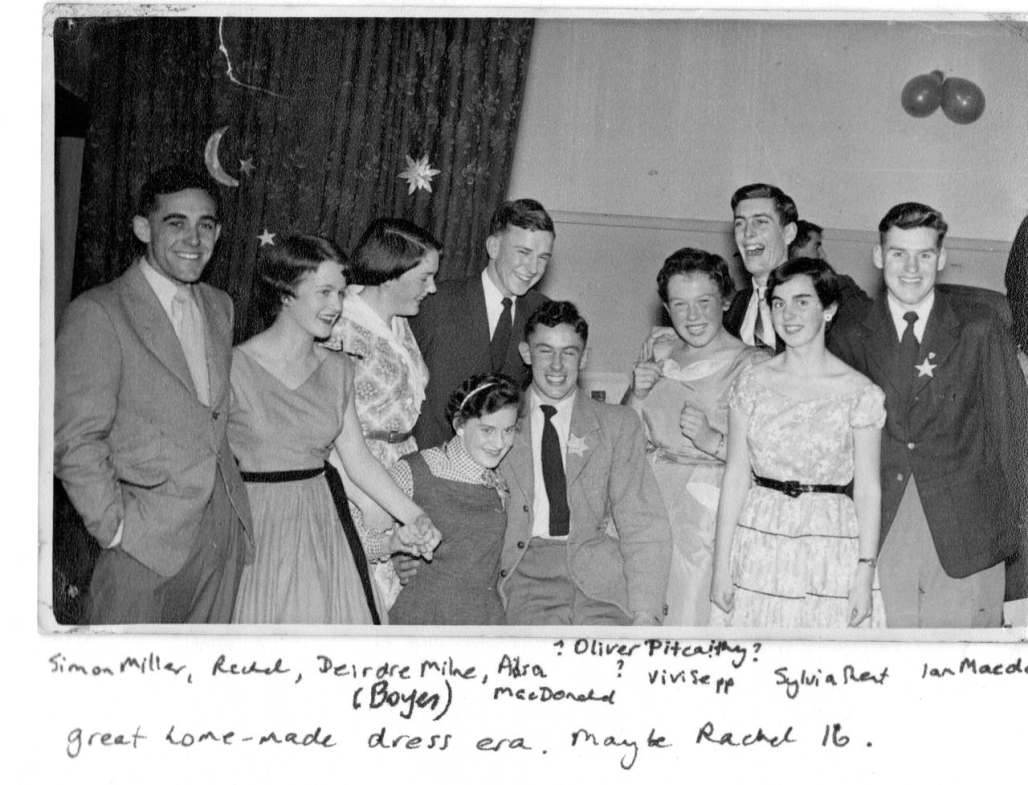 Black and white photo of 10 teenagers at a party, 1950s; hand-written notes name the people