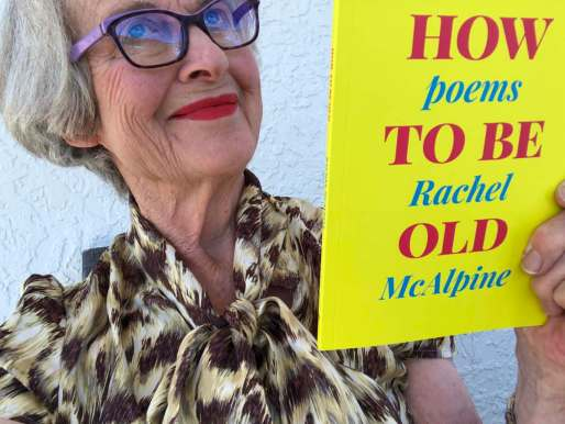 Poet gazing into the heavens while holding a book called How To Be Old, poems by Rachel McAlpine