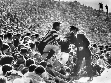 The crowd and the action spills over in 1956