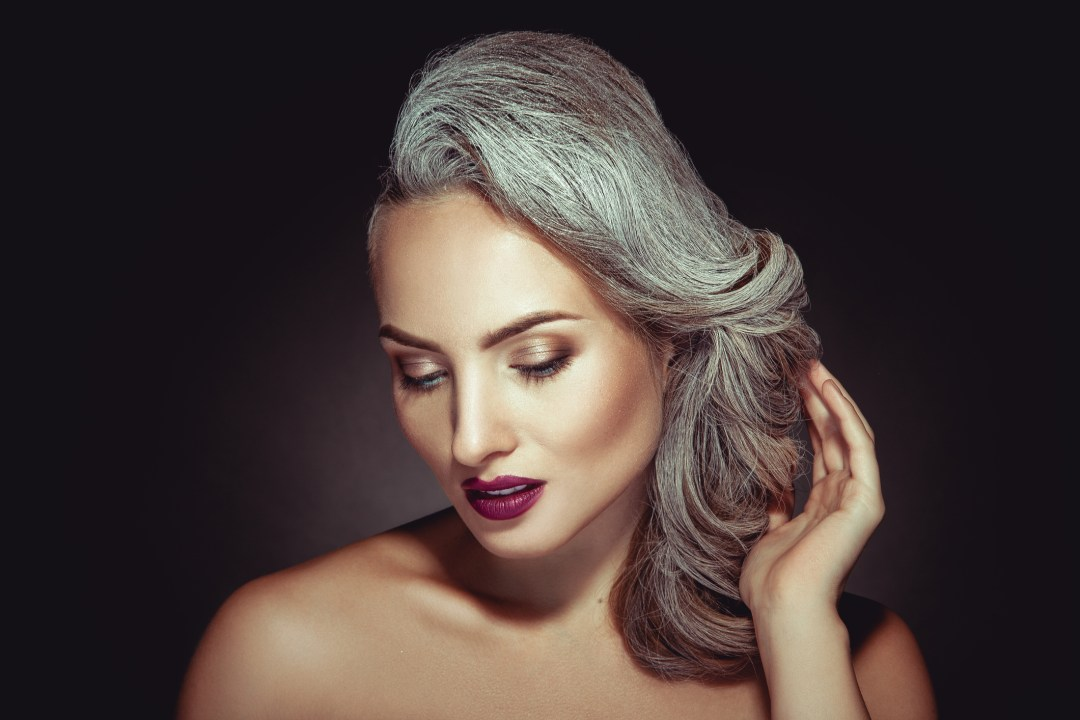Middle aged woman with beautifully styled grey hair