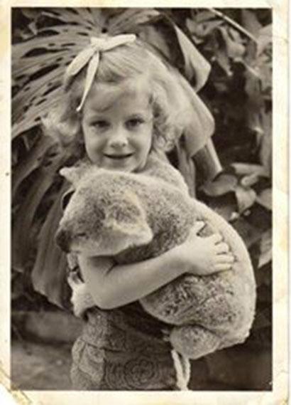 Australian child holding a koala