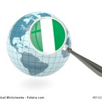 Magnified flag of nigeria with blue globe