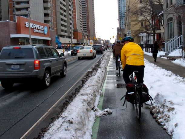 The one kinda separated bike lane in Toronto (Sherbourne St.) actually gets cleared of snow. Photo courtesy of Dandyhorse magazine.