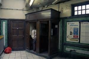 Wooden booths for the GPO's telephonic apparatus at Angel Tube. Not in an episode of Doctor Who, but in 1988. My Ray-Bans are just out of shot.