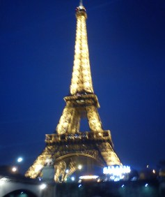 Eiffel Tower at night, lit up.
