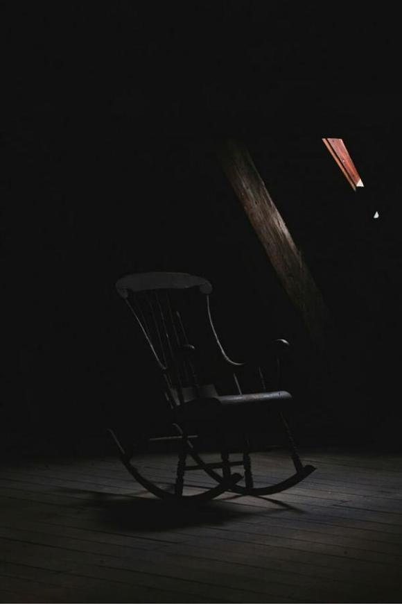 somber dark place with a rocking chair