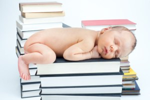 Canstock-2016-Dec-Baby-sleeping-on-books.jpg
