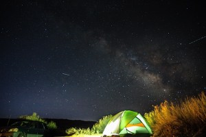 Camping tent under a night sky