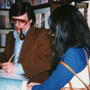 Harlan Ellison signing a book