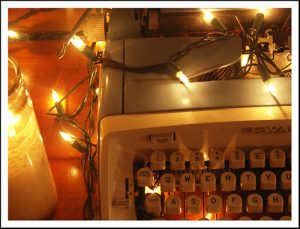 typewriter adorned with Christmas lights