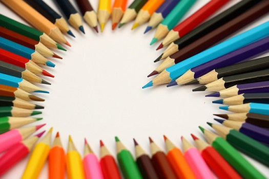 Multi-colored pencils arranged in the shape of a heart