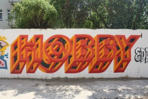 """graffiti on a wall, displaying the word """"hobby"""""""