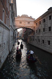 This is the bridge of sighs, which the guys on the gondolas will talk up as all about romance. In reality, the bridge connects what used to be the courthouse and the jail. The window gave prisoners their last glimpse at freedom, hence the sighs.