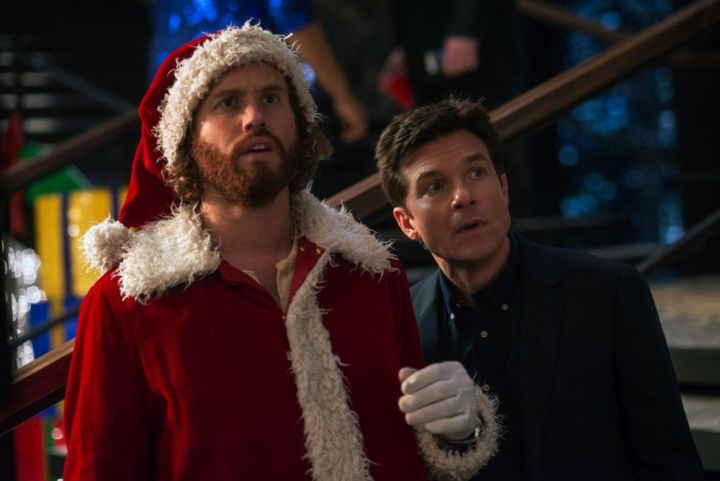 L-R: T.J. Miller as Clay Vanstone, Jason Bateman as Josh Parker in OFFICE CHRISTMAS PARTY by Paramount Pictures, DreamWorks Pictures, and Reliance Entertainment