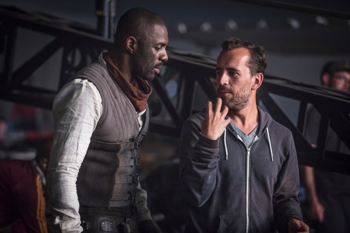 Idris Elba (L) discusses a shot with Director, Nikolaj Arcel (R)on the set of Columbia Pictures' THE DARK TOWER