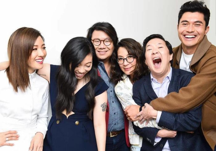Kevin Kwan (centre) with the crew and cast of Crazy Rich Asians