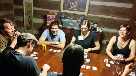 Students relaxing by playing a role play card game late one night