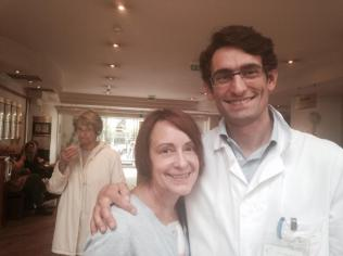 Debby, one day after having a defibrillator implanted, seen here smiling with her cardiologist