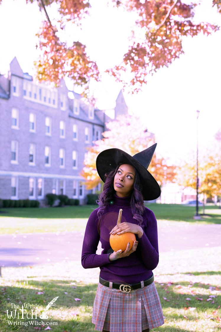 witch with pointed hat and pumpkin