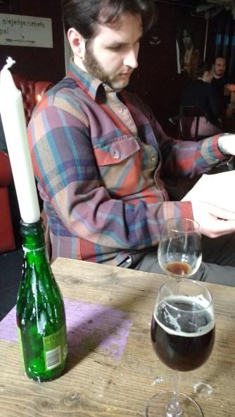 Joe studying the bottle list intently