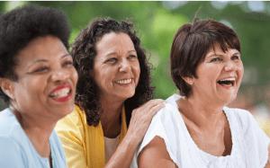 Group of three mature women smiling