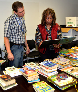 Clayton Finley and Cynthia Hightower help sort books for WRPS' United Way book drive.