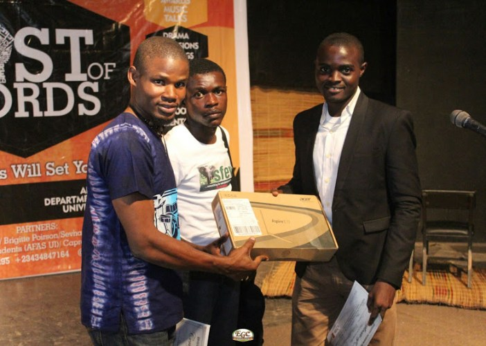 Winner of the AJPP 2015, Showunmi Olawale Michael collecting his prize, a brand new laptop