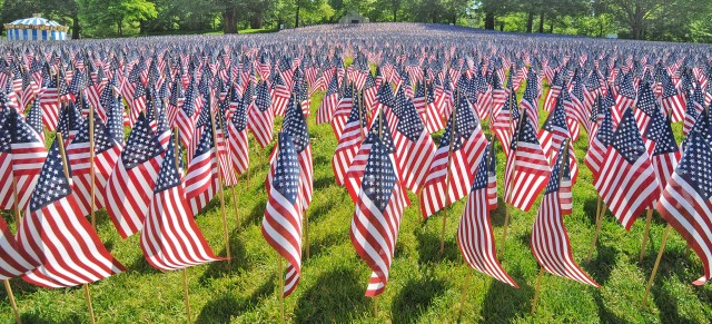 Flags honoring the 33,000 Massachusetts residents that died from the Civil War to present day adorn a field at the Boston common for the Remembering & Honoring our Massachusetts Heroes ceremony, Thursday, May 24, 2012. (AP Photo/Boston Herald, Patrick Whittemore)