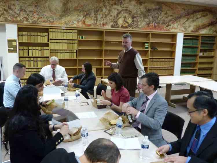 Lobbyist Jim Hedrick gives schedule updates during lunch break