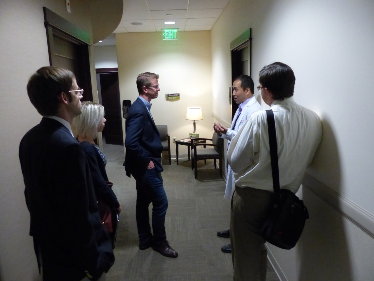 Congressman Kilmer - center - discusses healthcare policy challenges with radiologists while touring CMBC