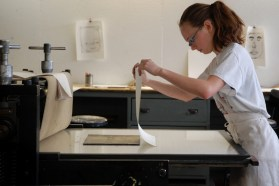 Eighth grade student proofs her etching plate