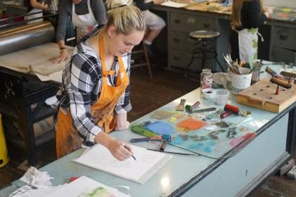 Studio Intern Morgan Allen prepares for a demo.