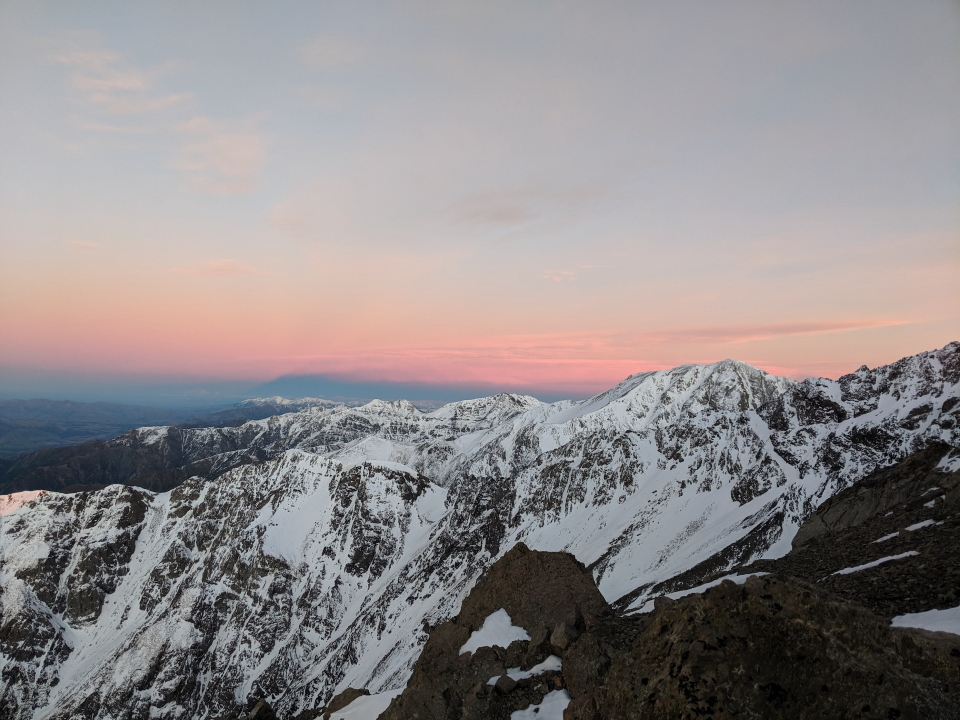 Sunrise over snow covered mountains